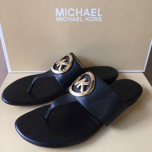 Michael Kors black leather gold emblem slip on